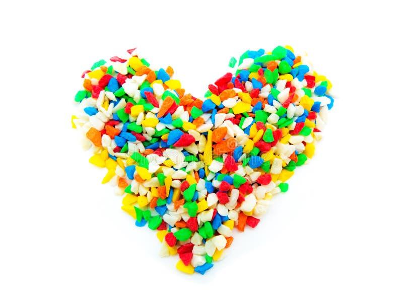 Corazón de piedra colorido en el fondo blanco fotografía de archivo libre de regalías