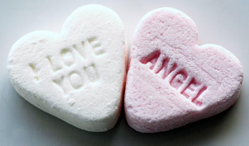 Corazón del caramelo con el mensaje fotos de archivo