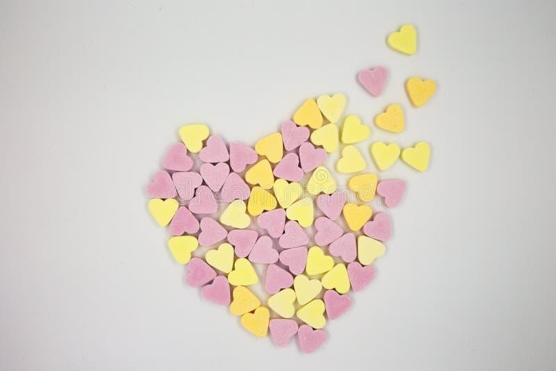Corazón del caramelo de Distingerating fotografía de archivo