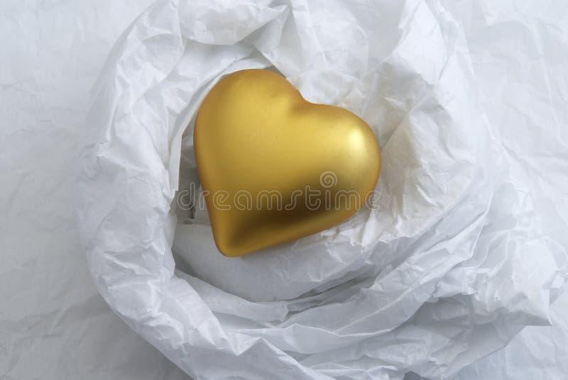 Corazón del oro imagen de archivo