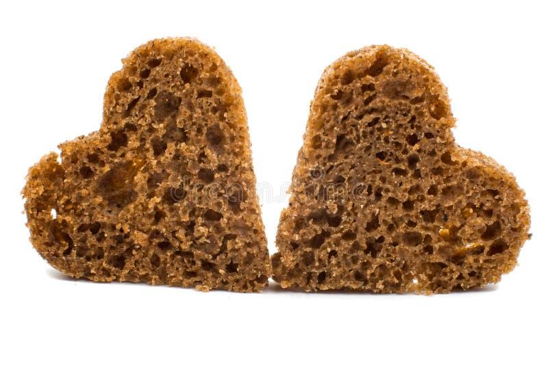 Corazón del pan negro imagen de archivo libre de regalías
