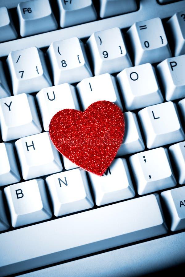 Corazón en el teclado foto de archivo