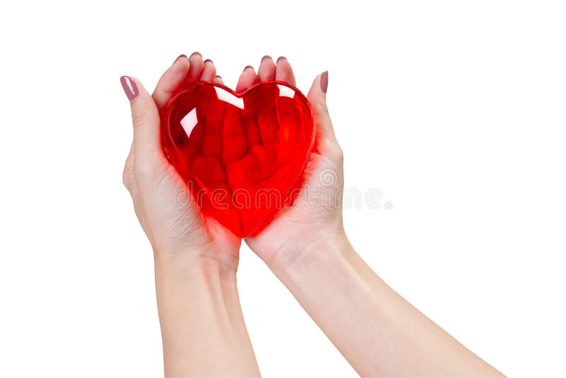 Corazón en las manos aisladas en el fondo blanco imagenes de archivo