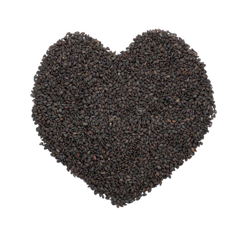 Corazón negro del sésamo fotografía de archivo