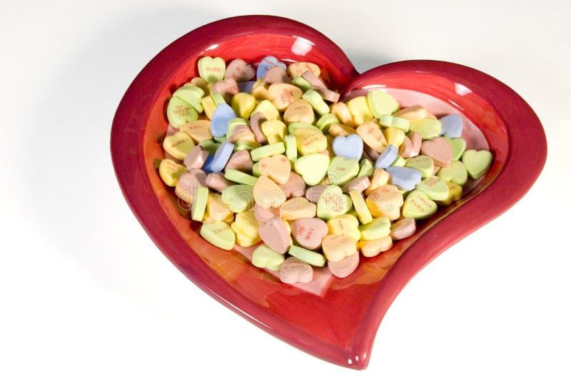 Corazón por completo del caramelo imagen de archivo