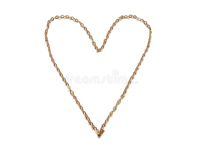 Corazón presentado de un encadenamiento del oro. imagenes de archivo