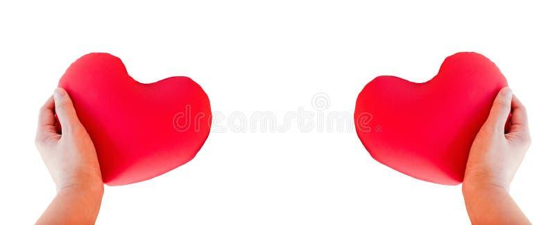 Corazón rojo del control de la mano del aislante para el concep precioso romántico de la tarjeta del día de San Valentín fotos de archivo libres de regalías