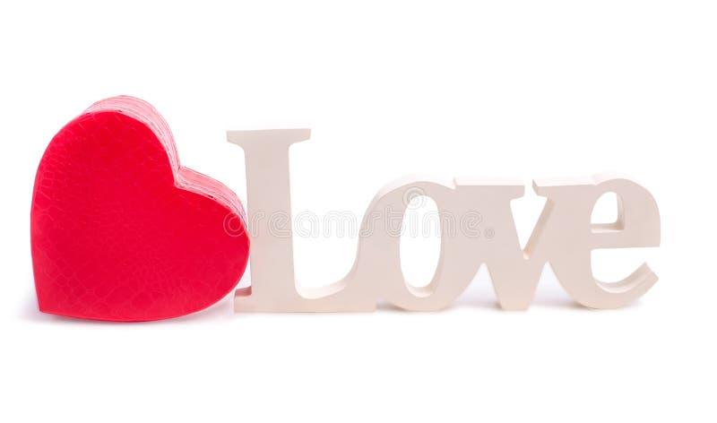 Corazón rojo y el amor de la palabra foto de archivo