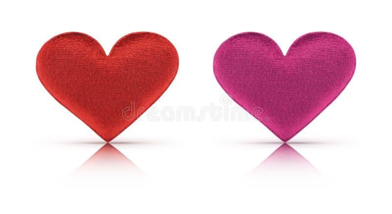 Corazón rojo y rosado de la tela con la trayectoria de recortes imágenes de archivo libres de regalías