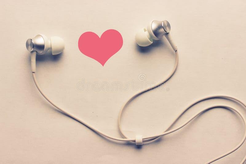 Corazón y auriculares fotografía de archivo