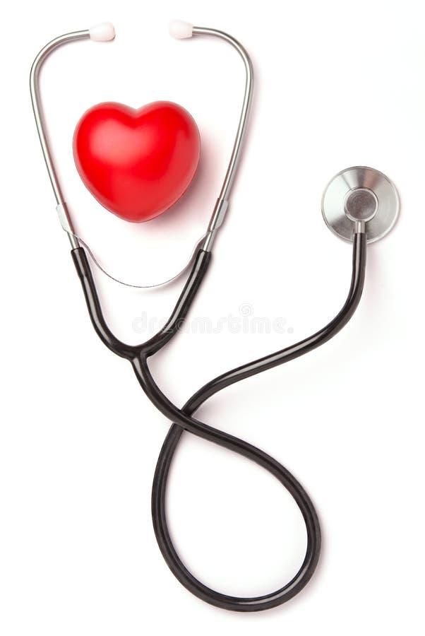 Corazón y estetoscopio rojos fotografía de archivo
