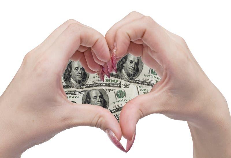 Corazón y manos del dinero fotografía de archivo