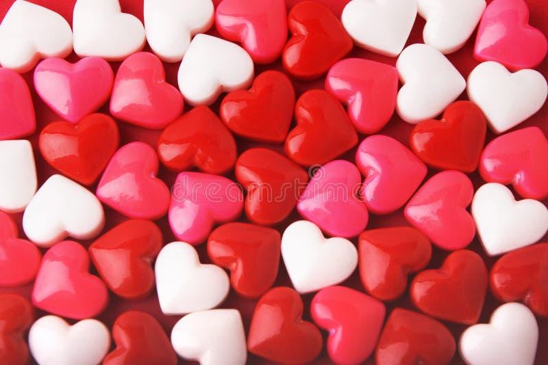Corazones de la tarjeta del día de San Valentín del caramelo foto de archivo