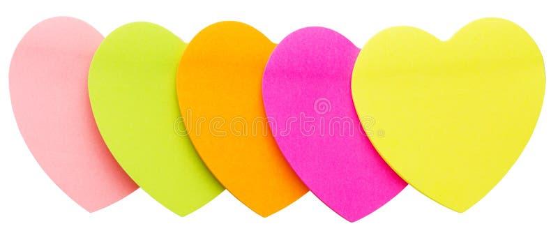 Corazones de papel coloreados multi foto de archivo