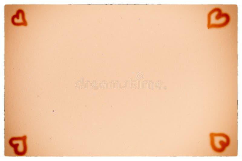 Corazones en fondo de papel anaranjado del vintage fotos de archivo