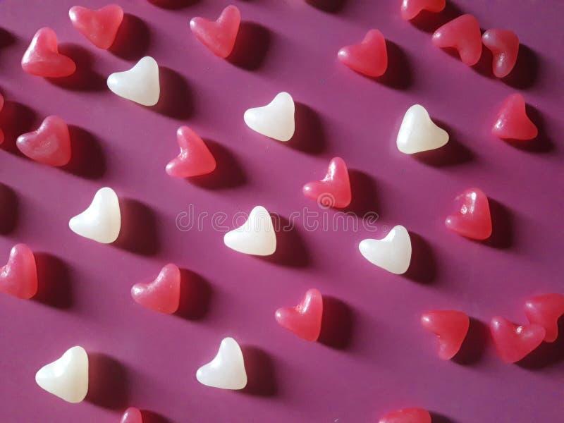 Corazones mucho fondo Concepto del día del ` s de la tarjeta del día de San Valentín foto de archivo