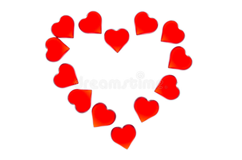 Corazones rojos brillantes en un fondo rayado bajo la forma de corazón grande Para utilizar día del ` s de la tarjeta del día de  imágenes de archivo libres de regalías