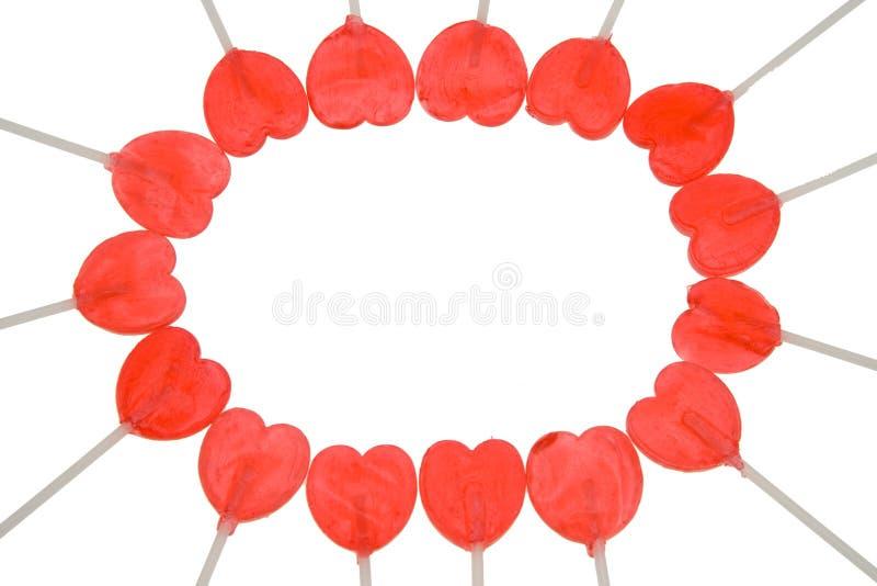 Corazones rojos del lollipop foto de archivo libre de regalías