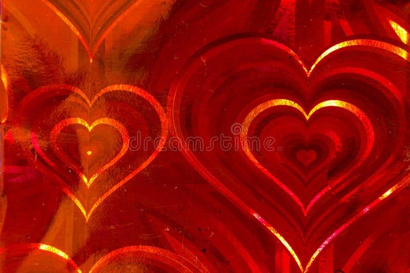 Corazones rojos olográficos imagenes de archivo