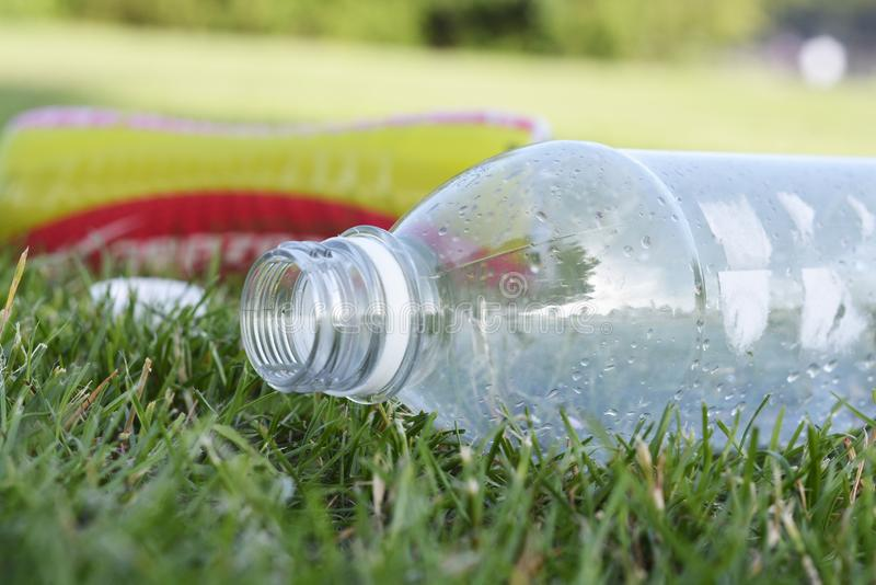 Corby, U.K., June 29, 2019 - empty plastic bottles garbage in the grass, zero waste, save planet stock image