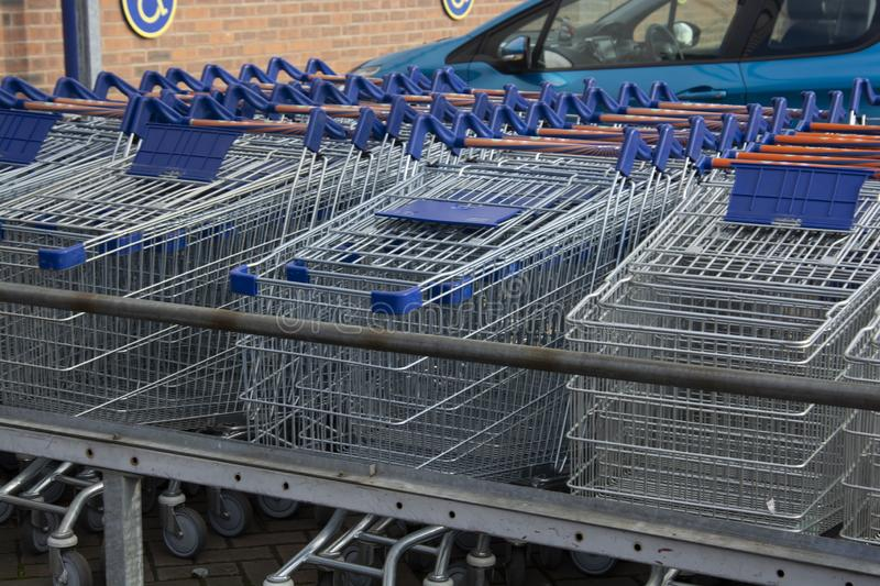 Corby, U.K, 19 March 2019 - A long row of shopping trolleys carts at LIDL Shop, outside of a large supermarket royalty free stock image