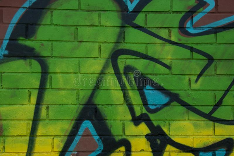 Corby, United Kingdom. April 4, 2019 - Green graffiti lettering on brich wall. Neon green piece of graffiti. Abstract background stock photo