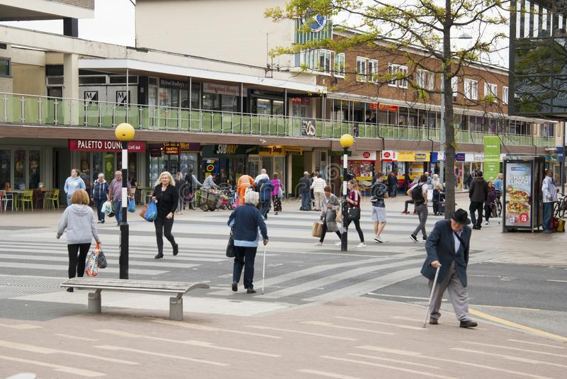 Corby, United Kingdom - august 28, 2018: Crowd of anonymous people walking on busy city street. End of summer day. royalty free stock image