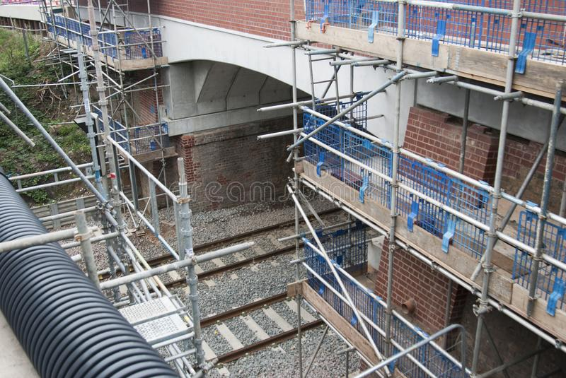 Corby, United Kingdom - August 29, 2018: old classical brik english building. Carried out scheduled repair work on the reconstruct stock images