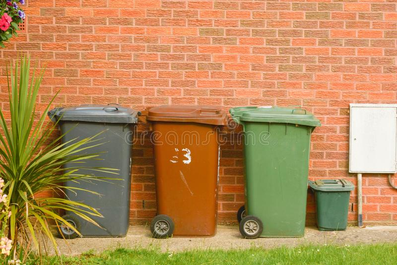 Corby, United Kingdom, 20 june 02019 - wheelie bin in front of a house, brick wall royalty free stock photos