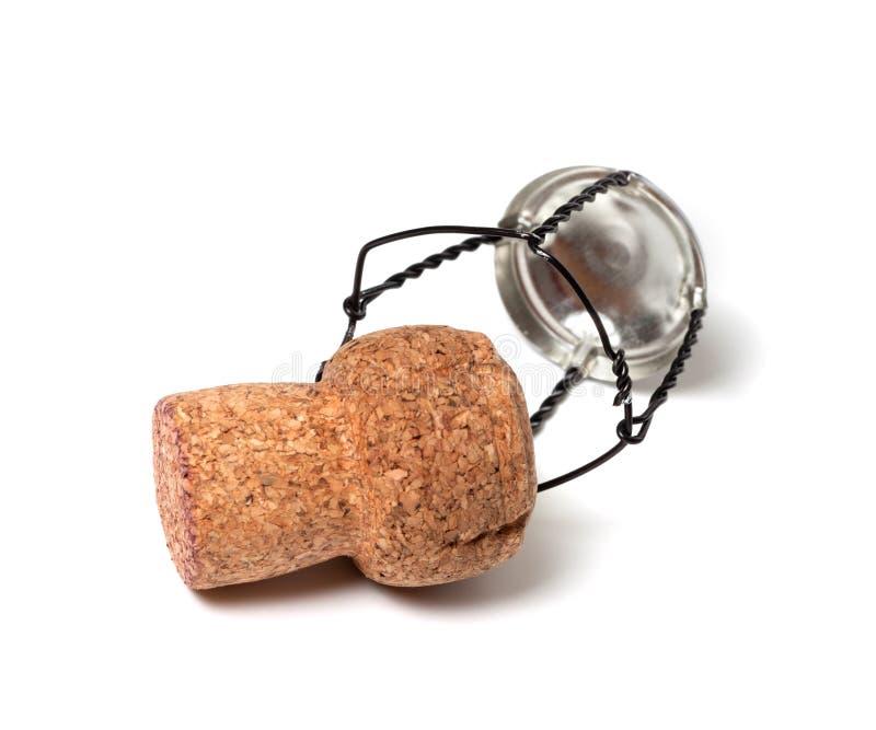Corcho y muselet del vino de Champán en el fondo blanco imagen de archivo