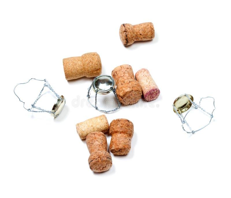 Corchos del vino del champán y muselets después del partido imagen de archivo libre de regalías