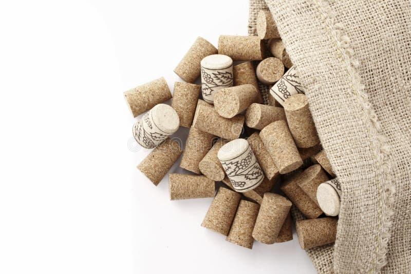 Corchos del vino en un bolso foto de archivo libre de regalías