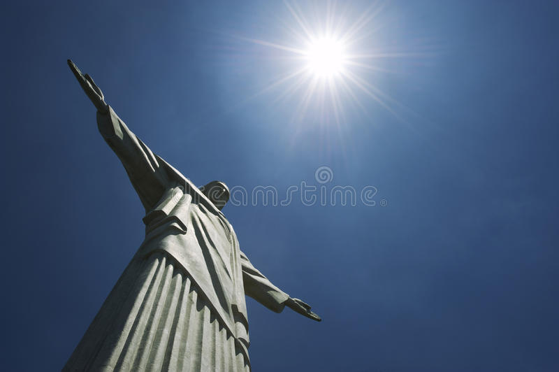 Corcovado Christ the Redeemer Rio de Janeiro Brazil Sun. Close-up of the statue of Christ the Redeemer at Corcovado Mountain standing against blue sky royalty free stock photography