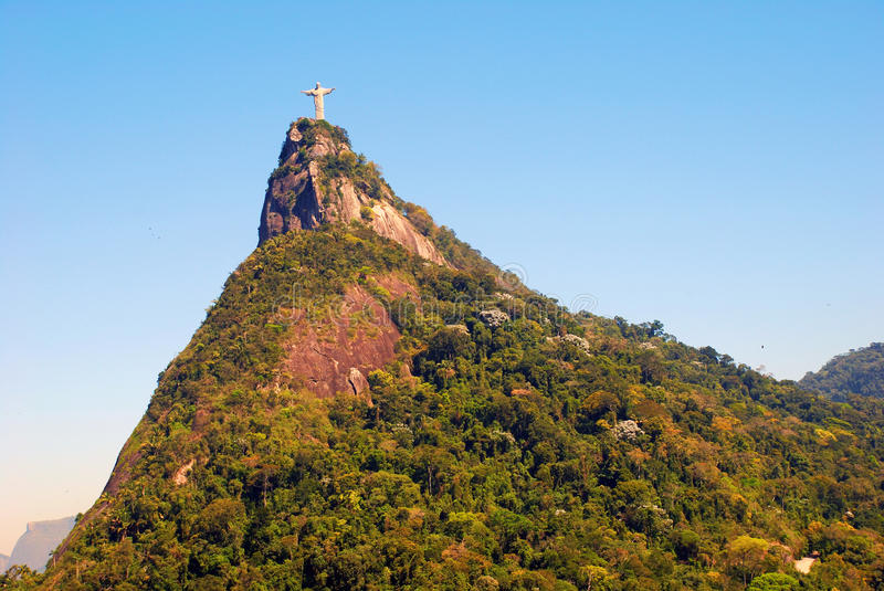 Corcovado mountain. Christ The Redeemer on top of Corcovado mountain.Rio de Janeiro - Brazil. It weighs 635 tons (700 short tons), and is located at the peak of royalty free stock images