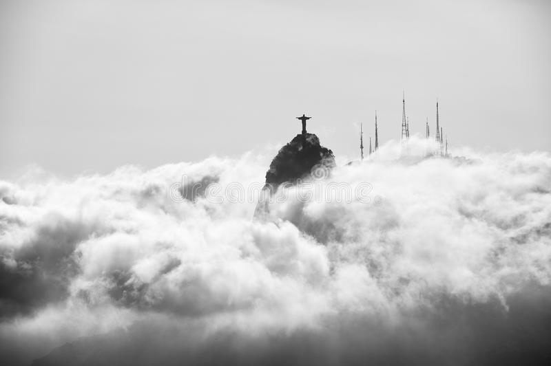 Corcovado Mountain Christ the Redeemer Rio Sunset Clouds. Corcovado mountain Christ the Redeemer standing above glowing swirling mist clouds Rio de Janeiro stock photos