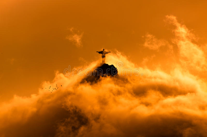 Corcovado Mountain with Christ the Redeemer Statue. In Clouds on Sunset in Rio de Janeiro, Brazil stock images