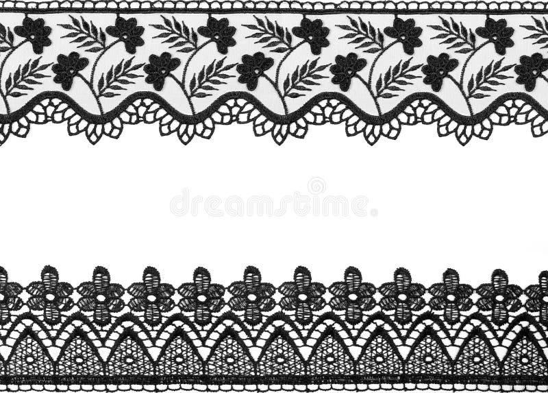 Cordón negro aislado en el fondo blanco fotos de archivo