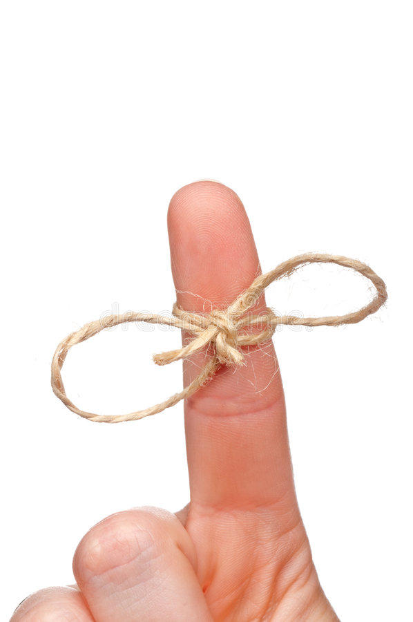 Corda amarrada em torno de um dedo como um lembrete fotografia de stock