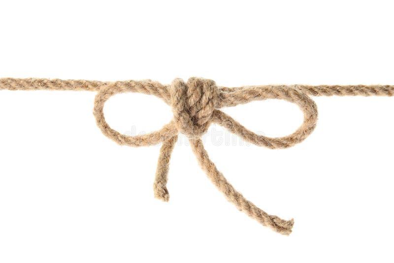 Corda della canapa con il nodo dell'arco immagini stock libere da diritti