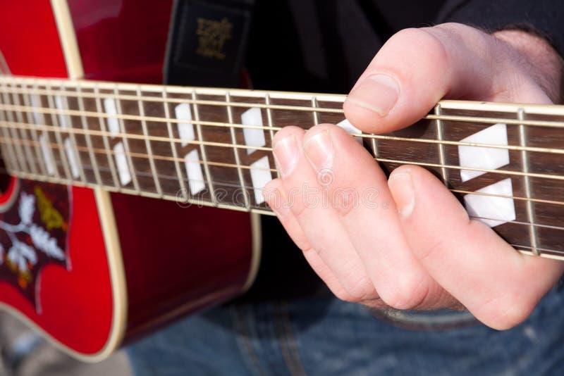 Corda Do Jogador De Guitarra Fotografia de Stock