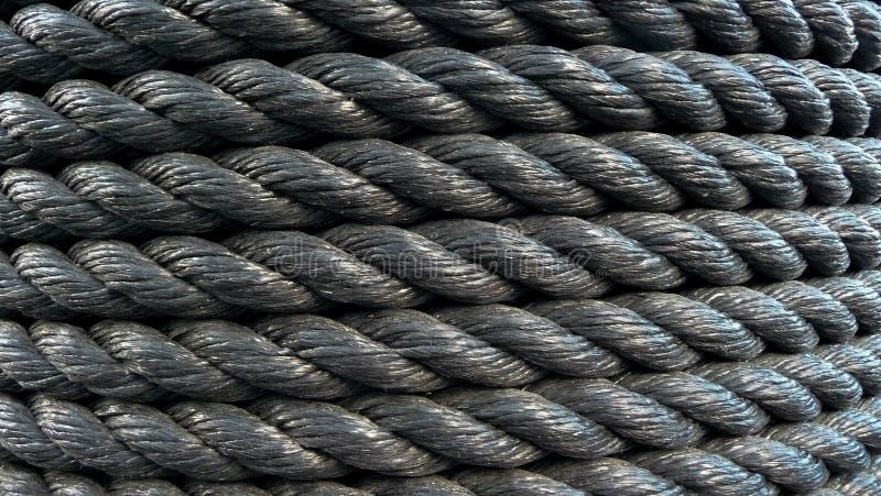 Corda do plástico do rolo Corda preta grossa imagem de stock
