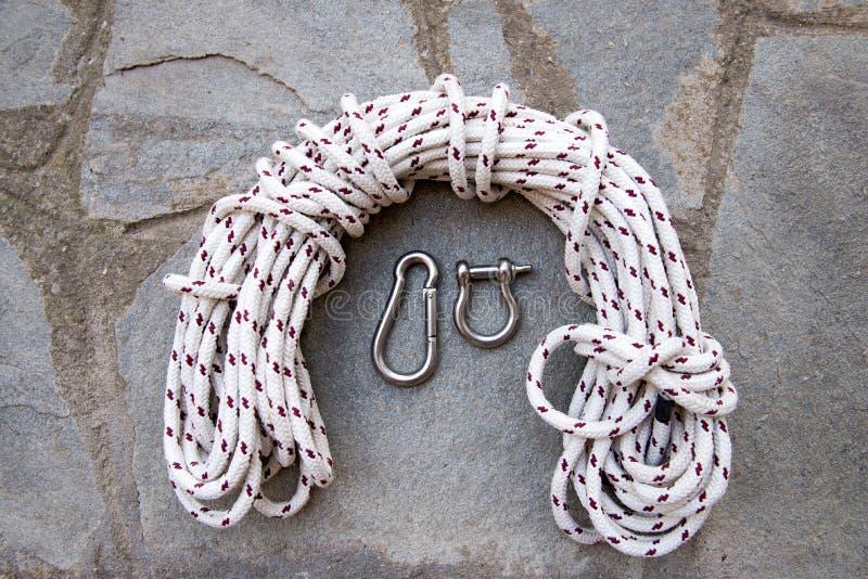 Corda e braçadeiras foto de stock