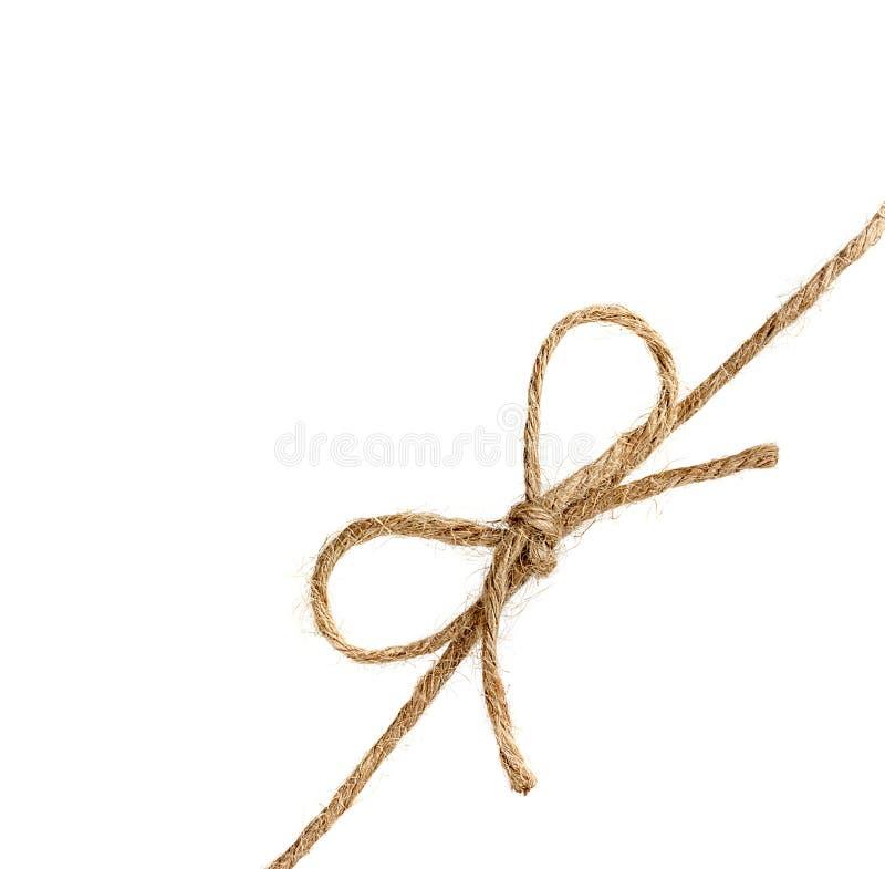 Corda ou guita amarrada em uma curva isolada no branco imagem de stock