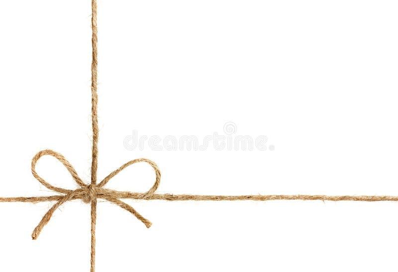 Corda ou guita amarrada em uma curva isolada no branco foto de stock