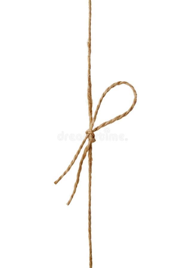 Corda ou guita do close up amarrada em uma curva isolada no branco fotografia de stock royalty free