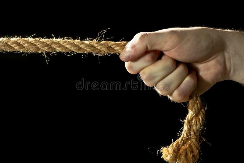 Corda puxando da mão foto de stock royalty free
