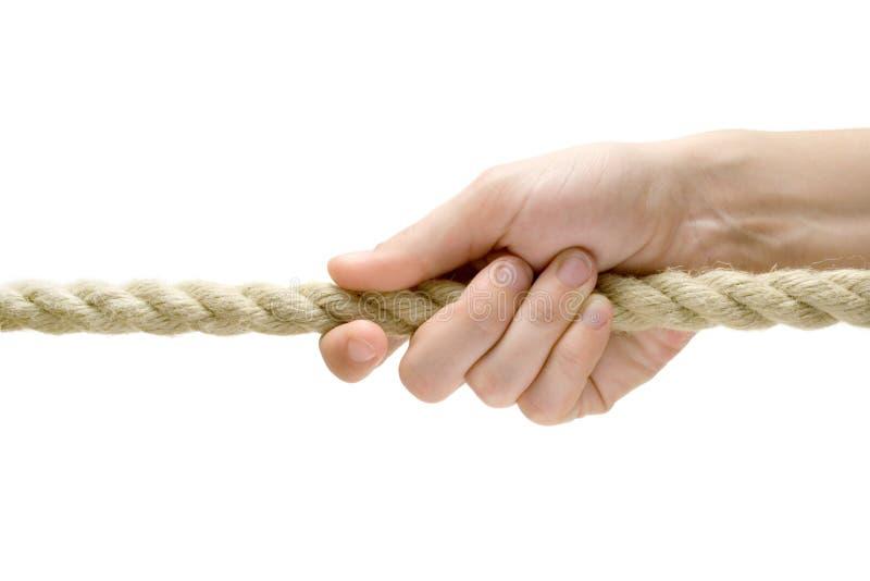 Corda puxando da mão imagem de stock
