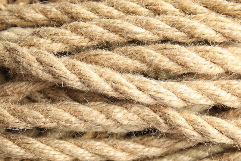 Cordas naturais do cânhamo como o fundo, imagem de stock