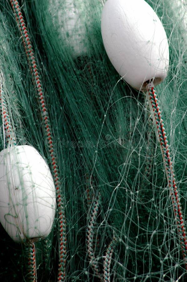 Cordas, redes e flutuadores de pesca foto de stock