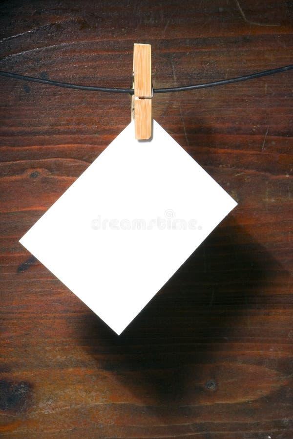 Corde de vêtements-cheville de livre blanc images libres de droits